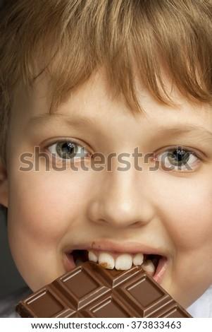 happy boy with chocolate bar - stock photo
