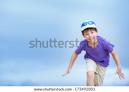 Happy boy with funny expression gesture outdoors - stock photo
