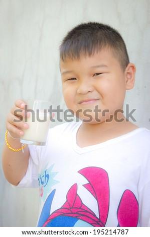 Happy Boy with Glass of Milk - stock photo