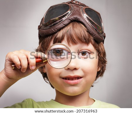 happy boy with magnifying - stock photo