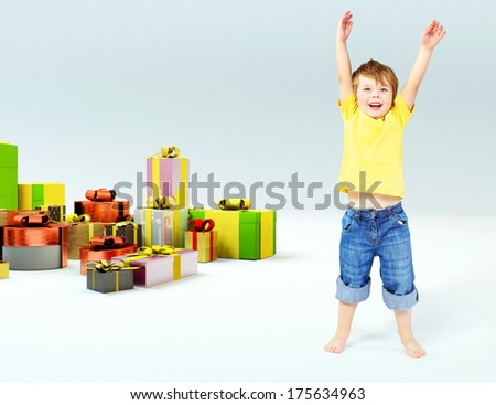 Happy boy with many gift boxes - stock photo