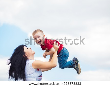 happy boy with mother  - stock photo