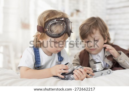 happy boy with retro camera - stock photo