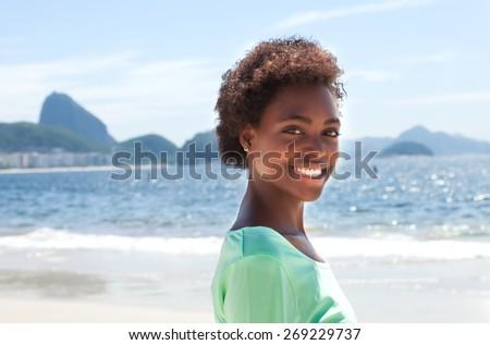 Happy brazilian woman at Copacabana beach - stock photo
