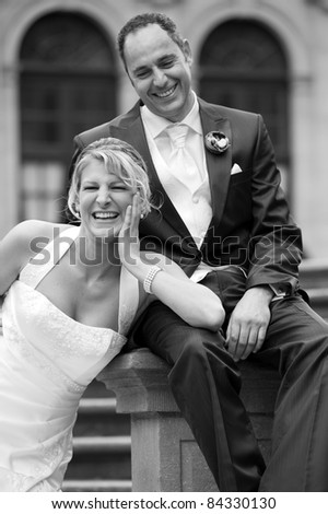 happy bridal couple in black and white - stock photo