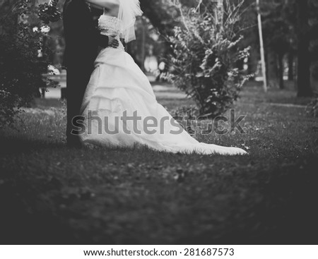 Happy bridal couple in forest. Summer wedding picture in black and white.  - stock photo