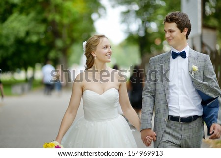 Happy bride and groom enjoying themselves in the city - stock photo