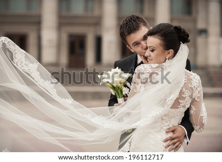 Happy bride and groom in a castle on their wedding day - stock photo