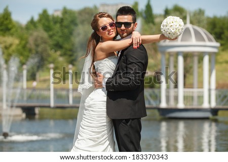 Happy bride and groom on their wedding day - stock photo