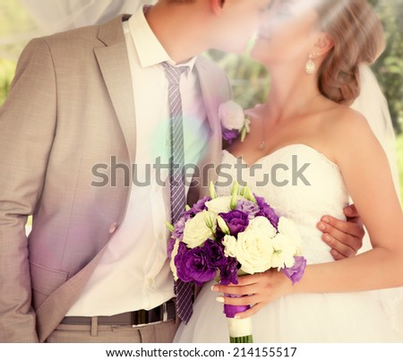 Happy bride and groom on their wedding. Wedding couple holding hands. Bride and groom holding hands. Wedding bouquet closeup. Fashionable toning. Selective focus  - stock photo