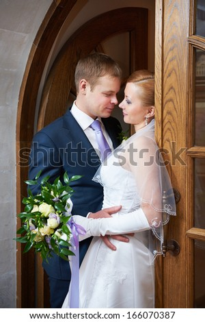 Happy bride and groom together in wedding day - stock photo