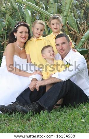 happy bride groom and children vertical - stock photo