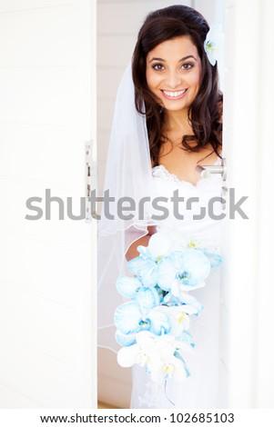 happy bride opening the door - stock photo
