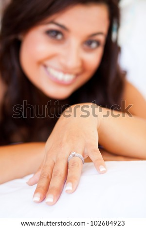 happy bride showing her wedding ring - stock photo