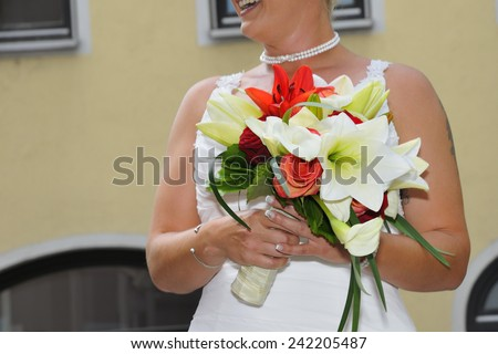 Happy bride with a wedding bouquet. - stock photo
