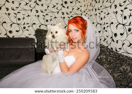 Happy Bride with her cute little dog - stock photo