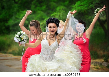 Happy bridesmaids enjoying with bride - stock photo