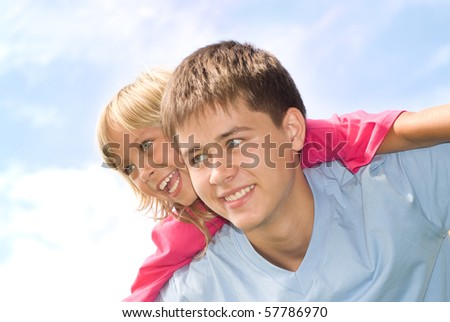 Happy brother and sister against the sky - stock photo