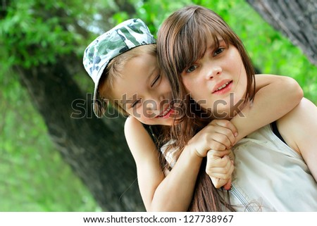 Happy Brother and Sister portrait outdoor - stock photo