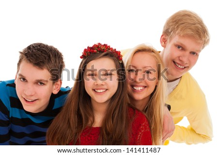 Happy brothers and sisters posing together isolated over white background - stock photo