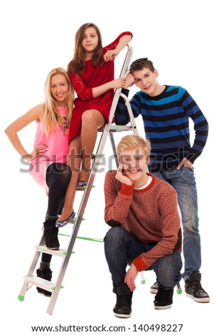 Happy brothers and sisters standing together - stock photo
