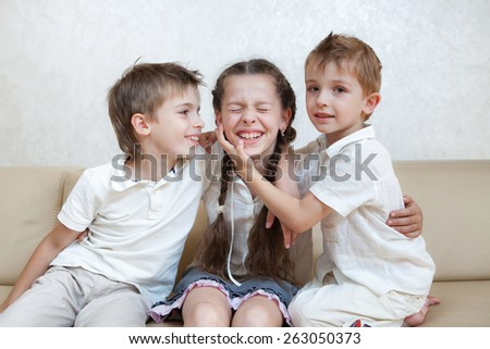 happy brothers and the sister - stock photo