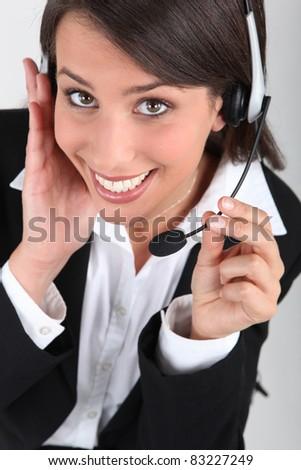 Happy brunette call-center worker - stock photo