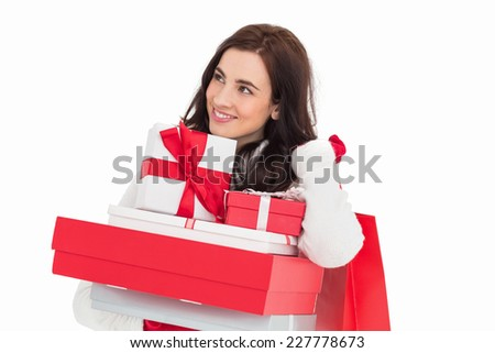 Happy brunette holding christmas gifts and shopping bags on white background - stock photo