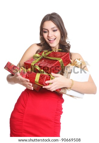Happy brunette with boxed gifts in her hand - stock photo