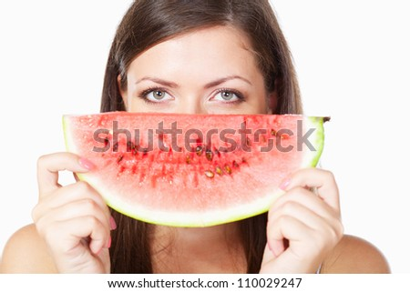 happy brunette woman behind watermelon over white - stock photo
