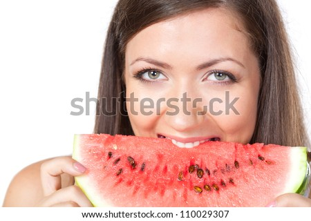 happy brunette woman biting slice of watermelon - stock photo