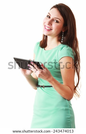 Happy brunette woman holding in hand new electronic tablet touch pad computer one finger touch digital screen and smiling  - stock photo