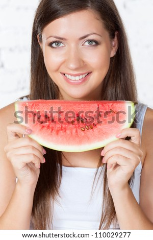 happy brunette woman holding watermelon - stock photo