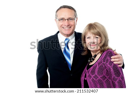 Happy business couple smiling at camera - stock photo