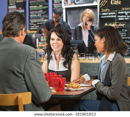Happy business executives taking a break in cafeteria - stock photo