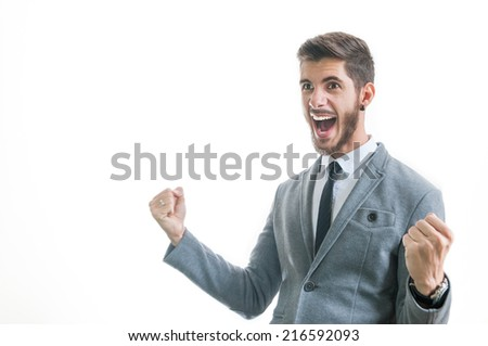 Happy business man celebrating successful deal and victory isolated on white with copy space for text. Worker feeling excited about getting promoted. Happy office situation concept. - stock photo