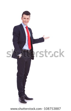 Happy business man giving presentation on white background , full body picture - stock photo