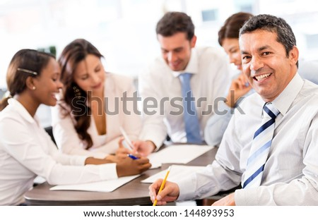 Happy business man in a meeting at the office - stock photo