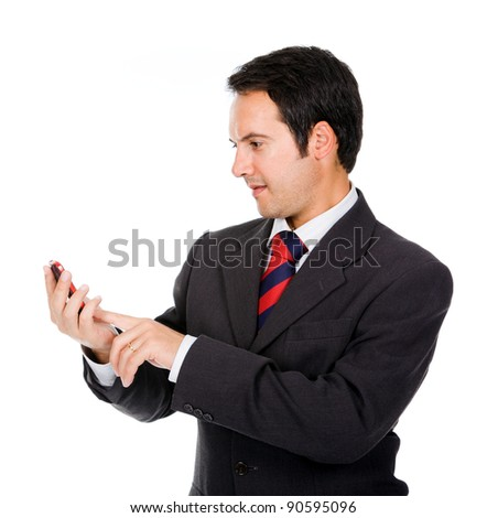 Happy business man reading an SMS on cellphone against white - stock photo