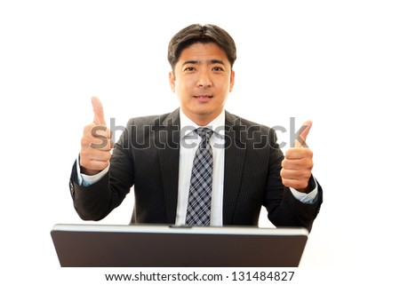 Happy business man showing thumb's up sign - stock photo