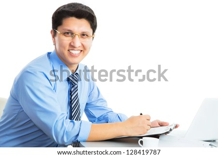Happy business man sitting in front of laptop on a white background - stock photo