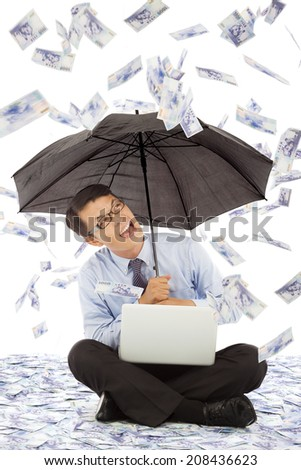 happy business man sitting on floor and holding a umbrella  - stock photo