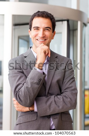 Happy business man smiling at the office - stock photo