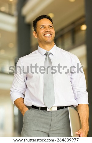 happy business man standing in modern office - stock photo