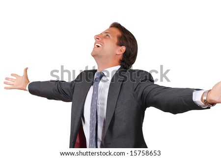Happy business man standing with open palms - stock photo