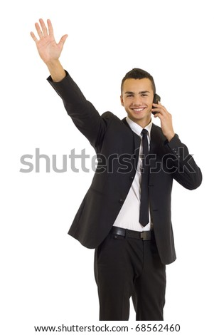 happy business man talking on the mobile phone and waving, isolated - stock photo