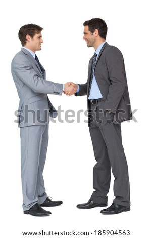 Happy business partners shaking hands on white background - stock photo