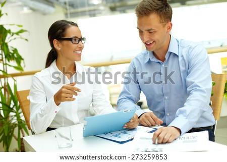 Happy business partners with touchpad planning work at meeting - stock photo