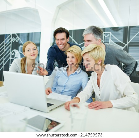 Happy business people getting computer training in the office - stock photo