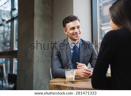 Happy business people having a coffee break in cafe - stock photo